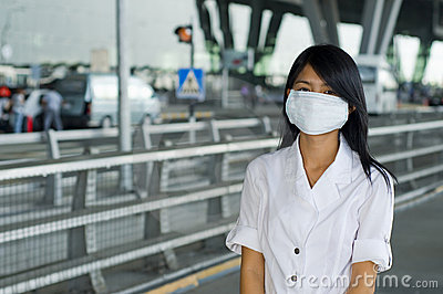 At bangkok intl airport with face mask