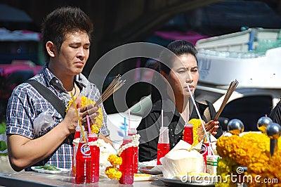 Bangkok, Thailand: Couple Praying at Shrine Editorial Stock Image