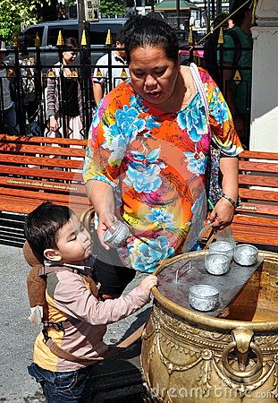 Bangkok, Thailand: Grandmother with Grandson at Shrine Editorial Stock Image