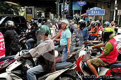 Bangkok, Thailand: Helmeted Motorcyclists Editorial Photo