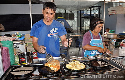 Bangkok, Thailand: Man Cooking Omelettes Editorial Stock Image