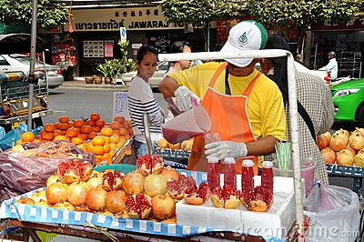 Bangkok, Thailand: Man Selling Pomegranate Juice Editorial Stock Image