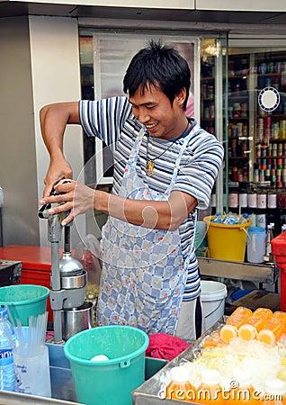 Bangkok, Thailand: Man Squeezing Oranges Editorial Stock Image