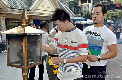 Bangkok, Thailand: Men at Erawan Shrine Editorial Stock Image