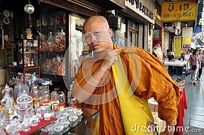 Bangkok, Thailand:  Monk on Phra Prachan Editorial Stock Photo