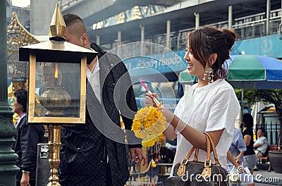 Bangkok, Thailand: People Lighting Incense Editorial Stock Photo