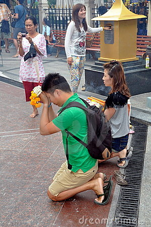Bangkok, Thailand: People Praying at Temple Editorial Photography