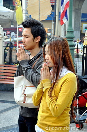 Bangkok, Thailand: Praying Couple at Erawan Shrine Editorial Stock Image