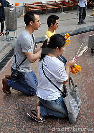 Bangkok, Thailand: Praying at the Erawan Shrine Editorial Photography