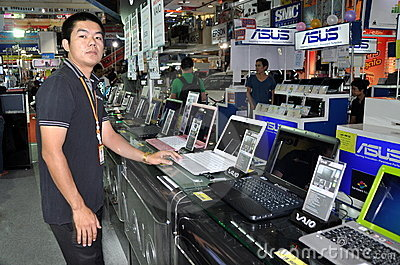 Bangkok, Thailand: Salesman with Sony Computers Editorial Stock Photo