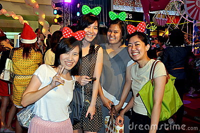 Bangkok, Thailand: Smiling Women on Christmas Eve Editorial Stock Image
