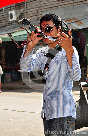 Bangkok, Thailand: Sunglass Vendor on Khao San Road Editorial Stock Image
