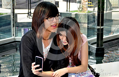 Bangkok, Thailand: Teenage Couple with Cellphone Editorial Stock Image