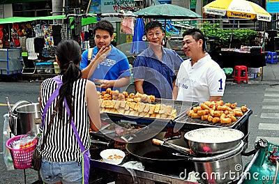 Bangkok,Thailand: Three Men Buying Food Editorial Photo