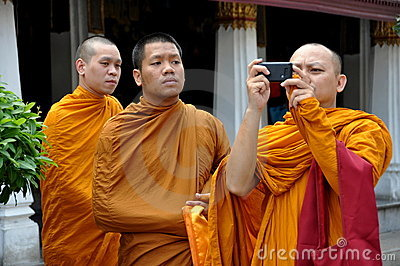 Bangkok, Thailand: Three Monks at Grand Palace Editorial Stock Image