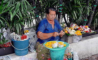 Bangkok, Thailand: Woman Selling Flowers Editorial Image