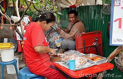 Bangkok, Thailand: Woman Slicing Pork Editorial Stock Photo