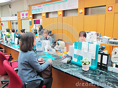 Bank counter service work Editorial Image
