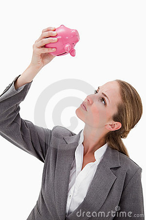 Bank employee looking at piggy bank
