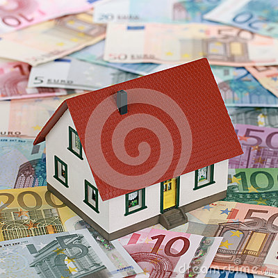 Bank financing a real estate with a house on banknotes