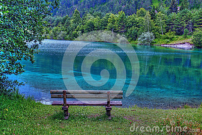 A bank in the turquoise-blue lake