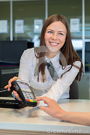 Free Bank Worker Offer To Pay By Credit Card Royalty Free Stock Photos - 40436478