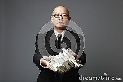Banker handing out cash