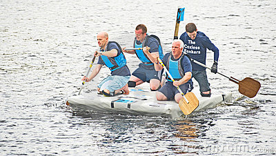 Bankers working for charity in raft race. Editorial Photo