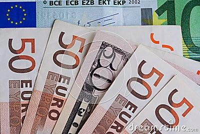 Banknote of 50 dollars among banknotes 50 euros