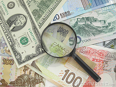Banknotes and magnifier