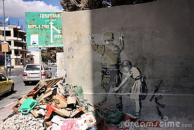 Banksy graffiti in Bethlehem, Palestine Editorial Stock Photo