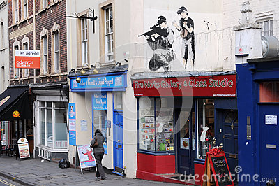 Banksy Graffiti Piece on a Street in Bristol Editorial Stock Photo