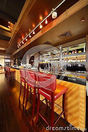 Bar counter in empty comfortable restaurant