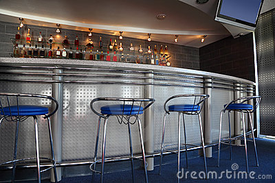 Bar interior with round counter and stools