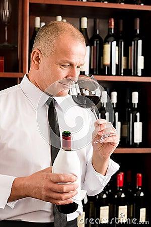 Bar waiter smell glass red wine restaurant