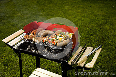 Barbecue in the garden, cook hand