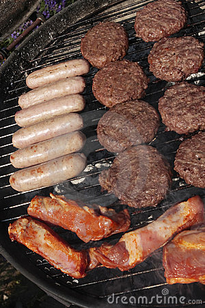 Barbecue grill with burgers and sausages