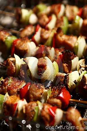 Barbecue with meat skewers