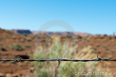 Barbed wire as divider to a desert