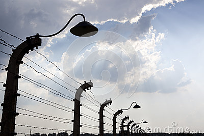 Barbed wire fence in impressive sky. Auschwitz Editorial Stock Image