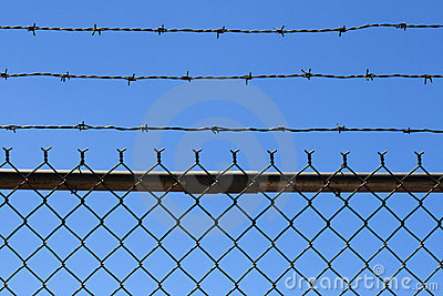 Barbed wire fence top