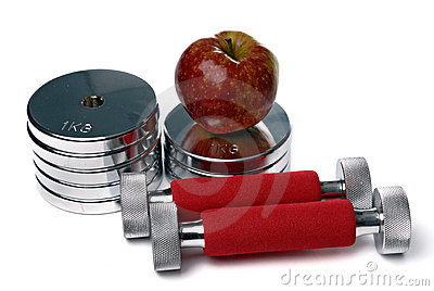 Barbells and apple isolated on white