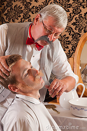 Barber cutting mustache