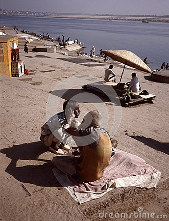 Barber at the ghats of  the Ganges in Banaras