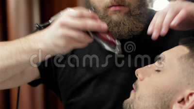 barber shave and modeling beard at the hair salon stock video video 61196773. Black Bedroom Furniture Sets. Home Design Ideas