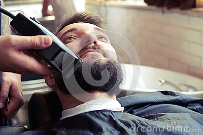 barber shaving beard. Black Bedroom Furniture Sets. Home Design Ideas