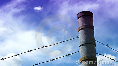 Barbwire fence on a blue sky