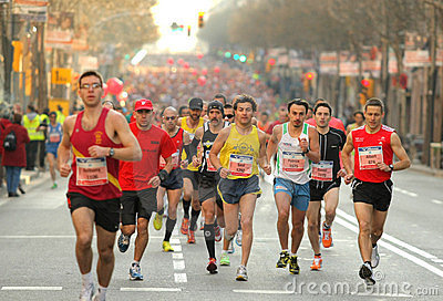 Barcelona street crowded of athletes running Editorial Photo