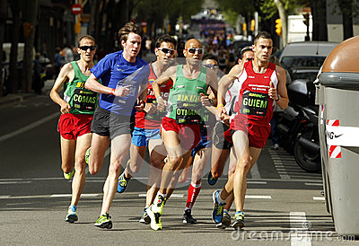 Barcelona street crowded of athletes running Editorial Stock Image