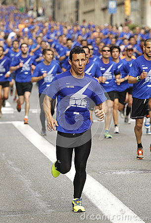 Barcelona street crowded of athletes running Editorial Image